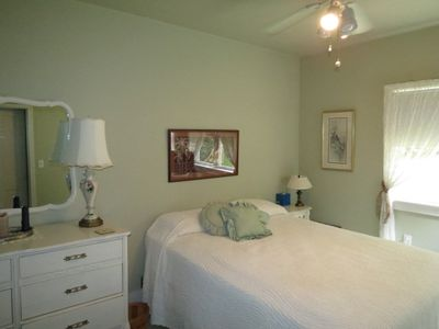 Master Bedroom downstairs with queen bed. Ceiling fan.