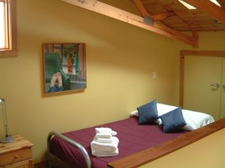 Michigan City house photo - sleeping loft with opening skylight sleeps 2 more.