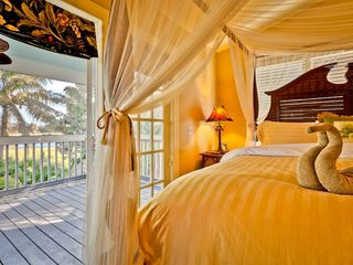 Key West house photo - The master bedroom has French doors to a private porch.