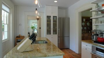 Granite counters in well-lit kitchen