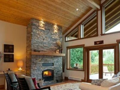 Great room -open concept house with huge vaulted ceiling