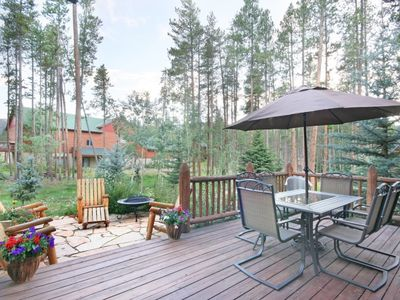 Back deck with tables and grill, hot tub on other deck