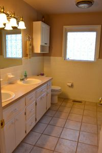 Full bath on main level includes tub/shower & double sink vanity