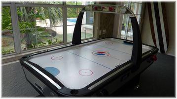 NEW! We have just upgraded to an Arcade Size Air Hockey Table in the Game Room.