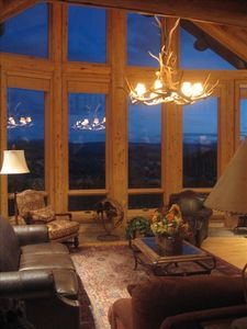 Deer antler chandelier and windows in great room