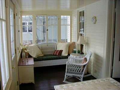 Glassed-in seasonal porch-perfect for morning coffee, reading or napping!