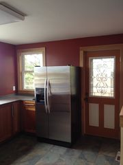 Duluth house photo - Refrigerator with water/ice maker. Door out to deck.