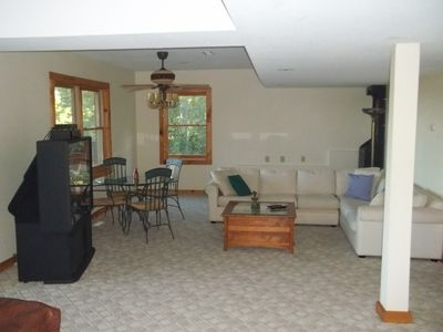 Basement livingroom/recreation room view showing game area and dart board