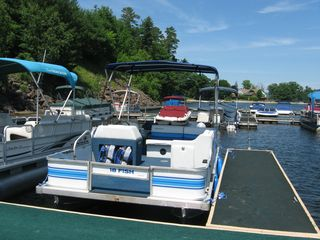 Day house photo - Pontoon Boat at Marina (complete with stowed life vests & accessories)