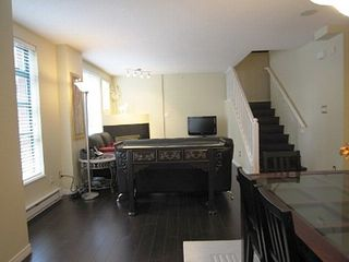 Vancouver townhome photo - Beautiful & brand new dark wood flooring throughout except kitch & bath in tiles