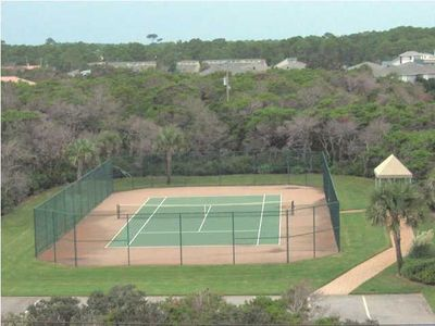 Tennis courts in the back of property