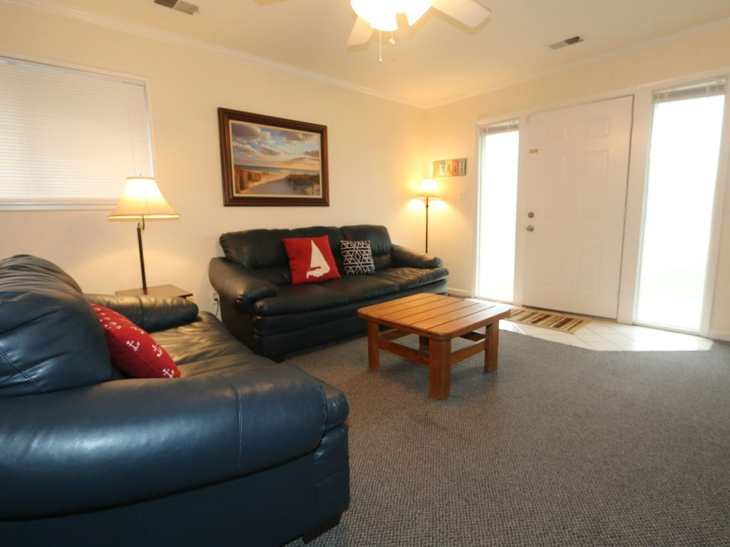 North end beach condo with pool short walk vrbo for Living room north end