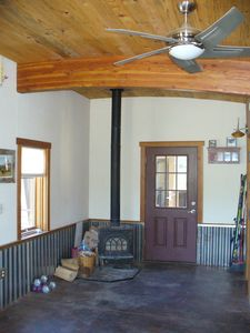 In-floor radiant heat and a high-effiency, yet romantic wood burning stove