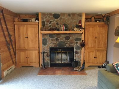 Wood Burning Fireplace with Cedar Log Mantle and Stone