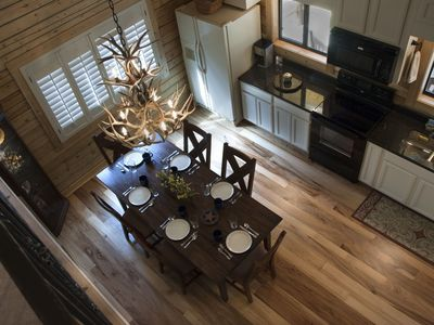 Waco cabin rental - Dining room & kitchen seen from loft