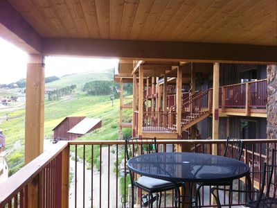huge deck with our own table and chairs - looking to slopes