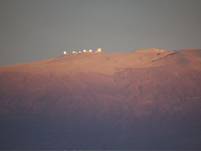 View of MaunaKea from home with a telephoto lens.
