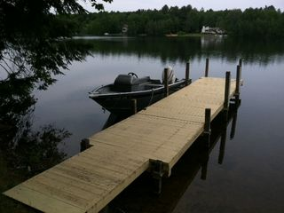 Barnstead house photo - the dock at sunset (sorry, the fishing boat is not included in rentals)