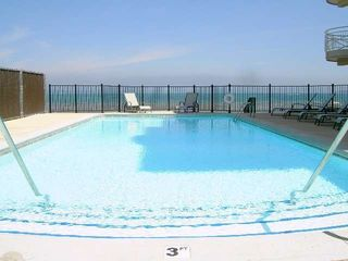 Traverse City condo photo - Pool w/beach and bay beyond