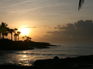 Punta Cana villa photo - Witnessing a beautiful sunrise while sipping coffee on the patio.