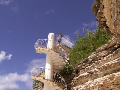 We'll begin your tour with the spiral staircase leading to our boutique beach.