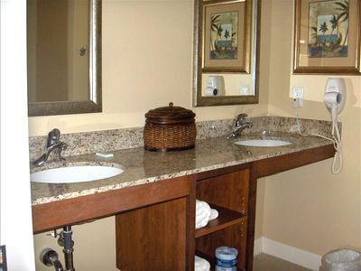 Master bedroom bath area with dual sinks and granite counter tops.