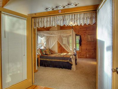 Sevierville cabin rental - Queen Size bed behind French Doors