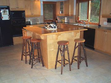 .spacious kitchen with an island that seats 4 (handmade stools)