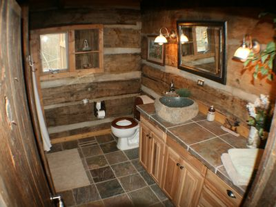 Maggie Valley estate rental - Bath with boulder rock sink