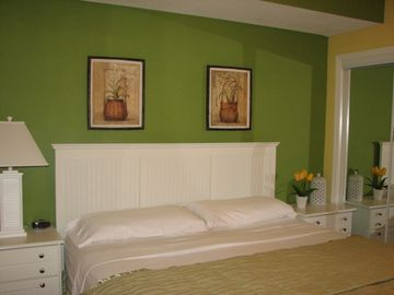 bedroom with king size bed (photo 1)