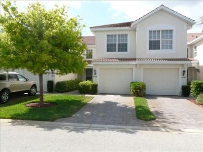 Stunning 1st Floor Waterfront Carriage Home W/ Attached Garage