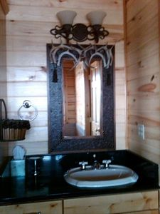 Pagosa Springs house rental - 4 en suite bathrooms attached to the 4 bedrooms. Granite tops & Kohler fixtures.