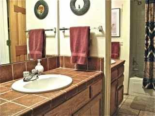 Bathrooms, half bath, and full bath with tub/shower, two vanities and toilets.