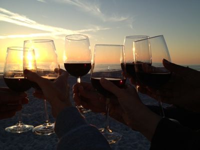 Toasting to a beautiful sunset steps away from your penthouse unit...
