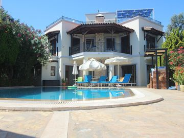 Villa with secluded private pool & garden and stunning sea & mountain views.