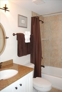 1 of 2 identical bathrooms, italian tiled tub-showers