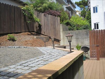 Huge back patio with zen garden.