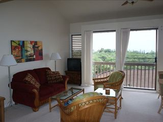 Makaha condo photo - Living Room facing golf course and ocean, TV replaced to a flat screen TV 12/11.