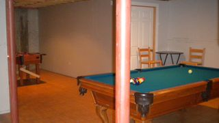 Game room with pool table and foosball table - Killington house vacation rental photo