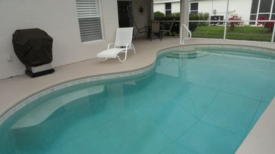 Our pool & patio area with new gas grill, 2 chaise loungers, table & 5 chairs.