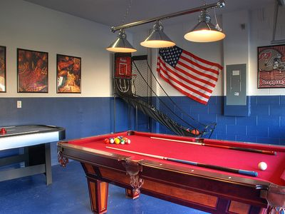 Games room with pool, air-hockey, foosball and basketball.