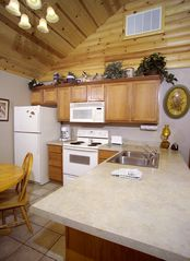 Branson cabin photo - Fully-equipped kitchen! Ready to make a meal from scratch and table service too