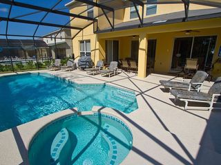 Large pool deck with lanai and gas heated spa - Emerald Island villa vacation rental photo
