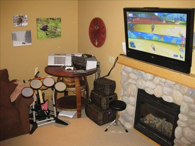 Plasma TV, gas fireplace, Wii, PS2, Rock Band, Guitar Hero, movies and games