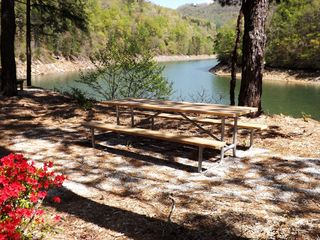 A short drive down your private road there are Picnic tables along Lake Fontana! - Bryson City cabin vacation rental photo