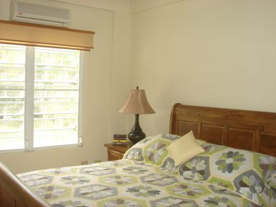 Master Bedroom with Queen Bed,A/C, Sliding Mirrored Closets, Dresser, Iron.
