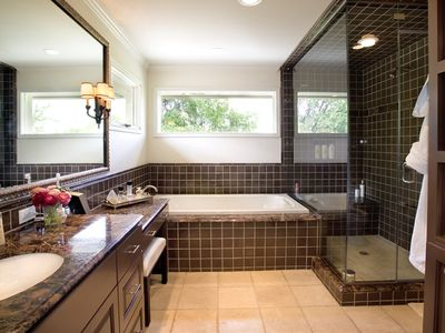 2 master baths. This is hers compete with soaking tub and...
