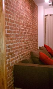 Queens studio rental - Exposed Brick Wall.