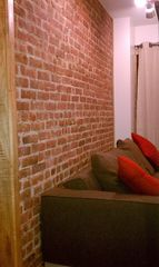 Queens studio photo - Exposed Brick Wall.