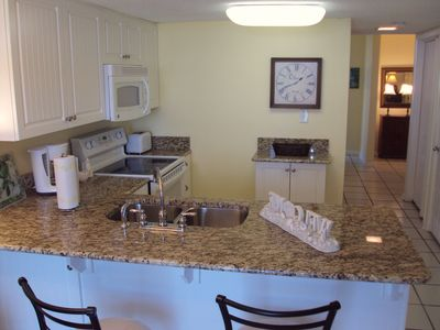 The kitchen has granite counter tops & is stocked with everything you need!!!